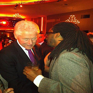 Recording Artist Allen Forrest having a conversation with President Bill Clinton at his 65th Birthday in Los Angeles