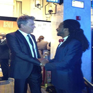 Recording Artist Allen Forrest shaking hands with legendary music producer David Foster