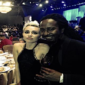 Recording Artist Allen Forrest with singer Miley Cyrus at Clive Davis Grammy Party